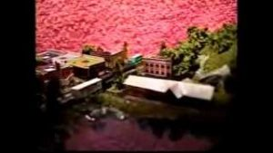 Miniature Model Railroad 9″ x 5″ running a train and trolley