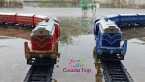 Centy toy trains on parallel tracks | epic train crossing in heavy rain | Toy Trains Galore !