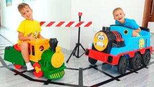 Vlad and Niki play with Toy Trains