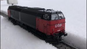 H0 scale Model trains running in the snow