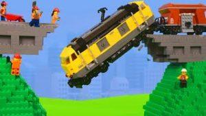 Construction Vehicles build a Bridge for a Lego Toy Train