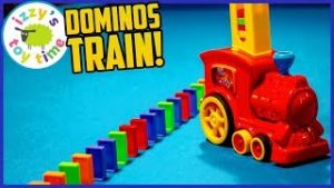 A TRAIN THAT STACKS DOMINOS?! THIS IS CRAZY! Fun Toy Trains Father and Son!